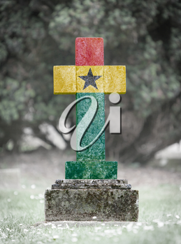 Old weathered gravestone in the cemetery - Ghana