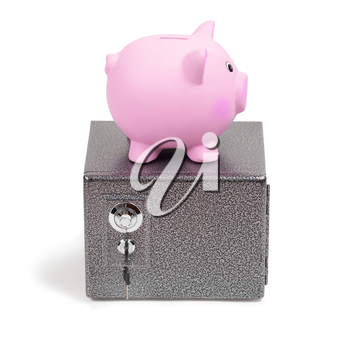 Pink ceramic piggy bank standing on a safe, isolated on white background. Keeping money in a safe or a bank, or in a piggy bank, economy, financials investments, savings for buying a house, a car, for retirement concept.