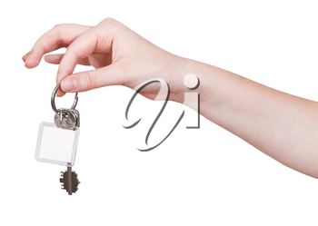 hand with door keys and blank key fob isolated on white background