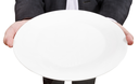 above view of businessman holds empty white plate close up isolated on white background