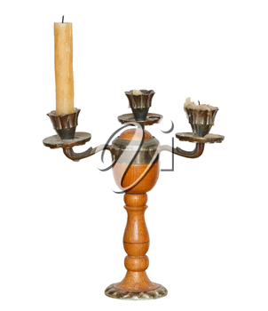 triple candlesholder with one candle isolated on white background