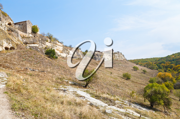Walls of ancient town chufut-kale on mountain in Crimea