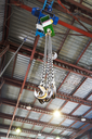 hooks of weigher bridge crane in hangar warehouse