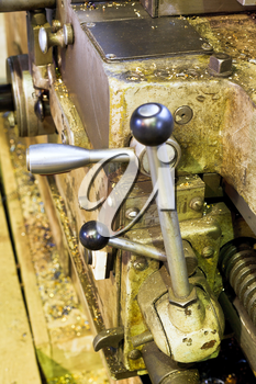 handles of tailstock of metal lathe machine close up in turning workshop
