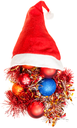 christmas gifts - xmas decorations and tinsel spill out from red santa hat on white background
