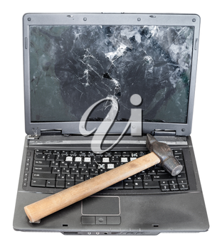 front view of old broken laptop with hammer on keyboard isolated on white background