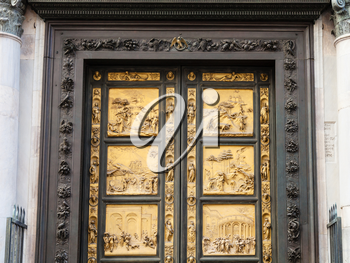 travel to Italy - closed outdoor East doors of Baptistery (Battistero di San Giovanni, Baptistery of Saint John), the doors are copy of Gates of Paradise made by Lorenzo Ghiberti in Florence city