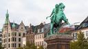 statue Absalon on Hojbro Plads square and urban houses in Copenhagen city