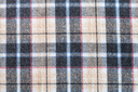 textile background - plaid twilled cotton fabric close up