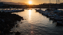 GIARDINI NAXOS, ITALY - JULY 6, 2011: yacht mooring in Giardini Naxos town on sunset. Naxos was founded by Thucles the Chalcidian in 734 BC, and since 1970s it has become a seaside-resort