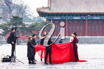 BEIJING, CHINA - MARCH 19, 2017: people in photosession on courtyard of Imperial Ancestral Temple (Taimiao, Working People's Cultural Palace) in Beijing Imperial city in spring