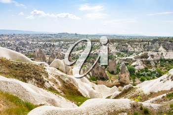 Travel to Turkey - view of mountain valley with Goreme town in Cappadocia in spring