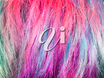 colorful dyed strands of female hairs close up