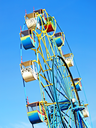 Colorful carousel against of the summer blue sky.