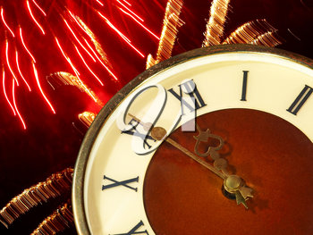 Clock face and bright firework taken closeup.Eve of new year.