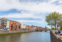 DUBLIN - MAY 17, 2014: Dublin Ireland is a popular tourist destination. Tourists walking alongside the River Liffey