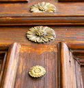 abstract  rusty brass brown knocker in a   closed wood door crenna gallarate varese italy