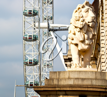 lion  london eye in the spring sky and white clouds