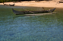 boat sand lagoon  water reflex and coastline in madagascar nosy be