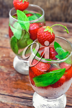 Two glass with glass of a cool drink of strawberries and mint.