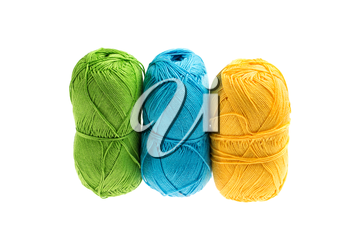 Colored yarn isolated on white background, studio shot, high depth of field