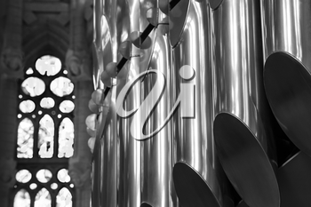 Closeup black and white photo of organ in Catholic Church