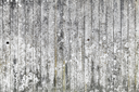 Faded gray concrete wall, flat detailed background photo texture