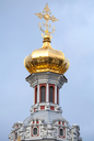 Golden dome with cross. Old Orthodox Church of the Nativity in St.Petersburg, Russia