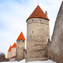 Ancient stone fortress walls with towers in row. Tallinn, Estonia