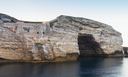 Bay of Bonifacio, coastal rocks with grotto. Mountainous Mediterranean island Corsica, Corse-du-Sud, France