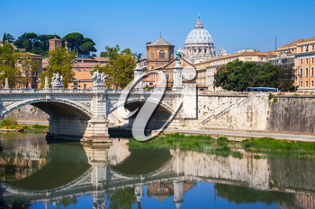Classical Rome cityscape with Ponte Vittorio Emanuele II. It is a bridge in Rome constructed to designs of 1886 by the architect Ennio De Rossi. St. Peters Basilica  dome dominates the skyline