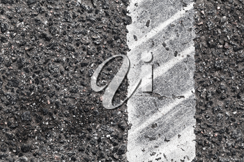 Dividing line with tire track over it, highway road marking fragment. Abstract transportation background