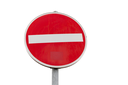Round red sign No Entry road sign isolated on white background, close up photo
