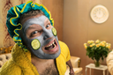 Strange, crazy man with face pack in home interior