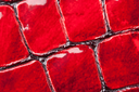 Close-up of red artificial leather background