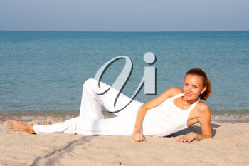 Tan smiling woman resting on the beach
