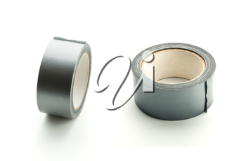 Two rolls of silver adhesive tape on white background