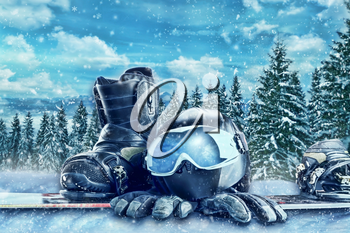 Winter sport glasses, ski, helmet and gloves on winter forest background