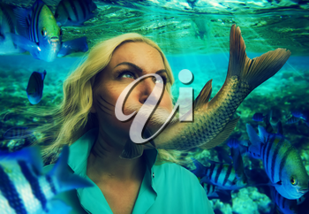 Woman's face smoothly changing to fishtail under the water
