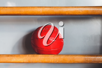 Red med ball on the shelf in the gym