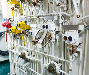 Engineering interior of military ship including pipes, cables, pumps