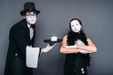Mime actors comedy performing with a glass of water. Pantomime theater performers