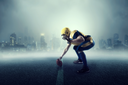 American football player with ball, cityscape on background. National league