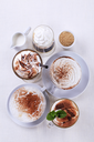 Variety of coffee and chocolate drinks - overhead
