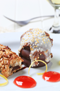 Chocolate-coated marshmallow teacake and fruit-filled bar cookie