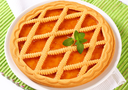 Round lattice topped apricot tart