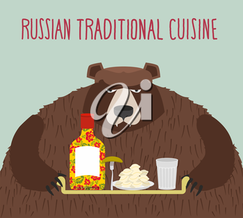 Russian national cuisine. Bear with a tray of traditional meal: vodka, dumplings and cucumber.