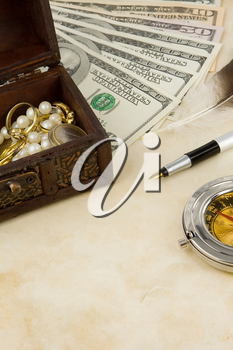 dollars, compass, box and euro coins on texture