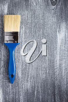 paint brush on wooden painted background texture