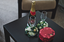 Table with champagne glasses and chocolates.